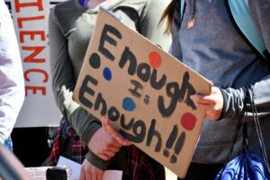 Enough is Enough hand painted protest sign, racial violence Stop Asian Hate BLM LGBTQ